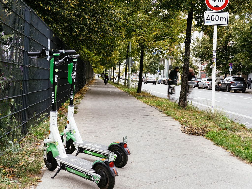 2 lime e-scooters parked on the street of Berlin