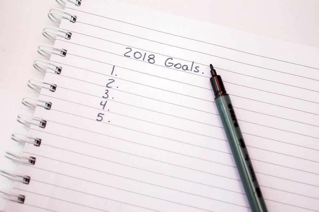 2018 Goals in Notebook with a Pen