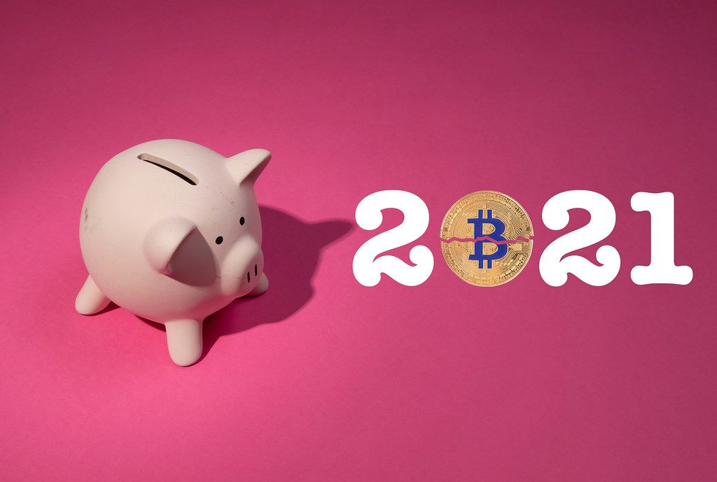 2021 text with Bitcoin and piggy bank on pink background