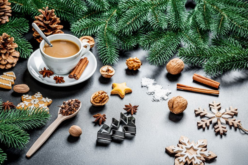 A cup of coffee with spicy biscuits. Christmas time