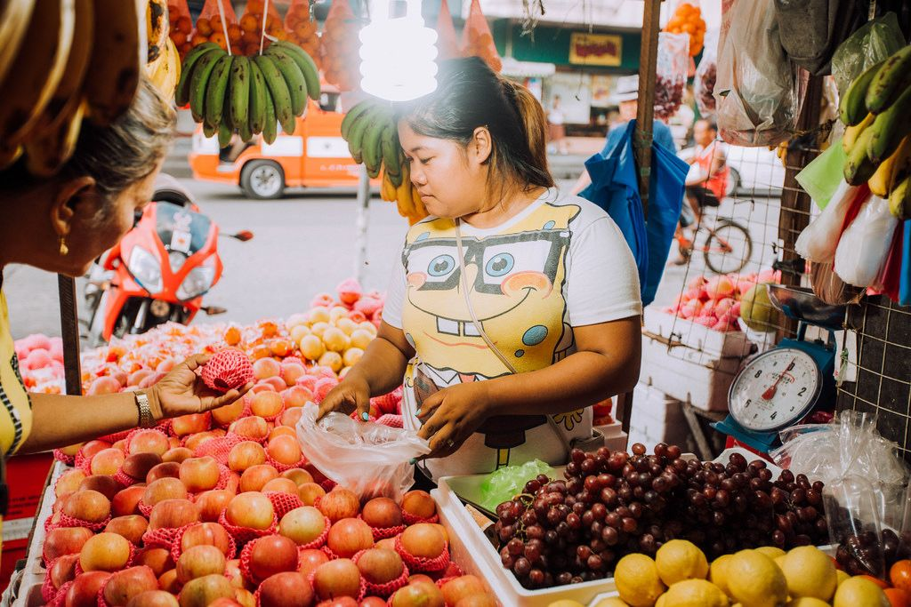 A fruit vendor selling at a sidewalk in Bacolod City