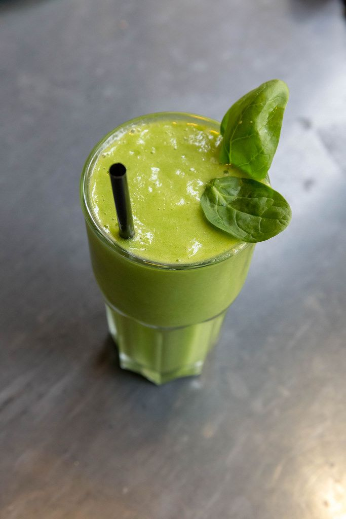 A green detox smoothie with spinach, basil and ginger