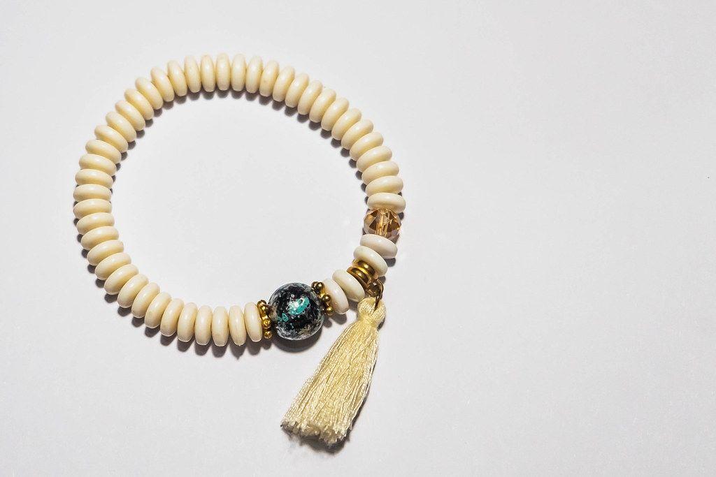 A handmade bracelet on white surface (Flip 2019)