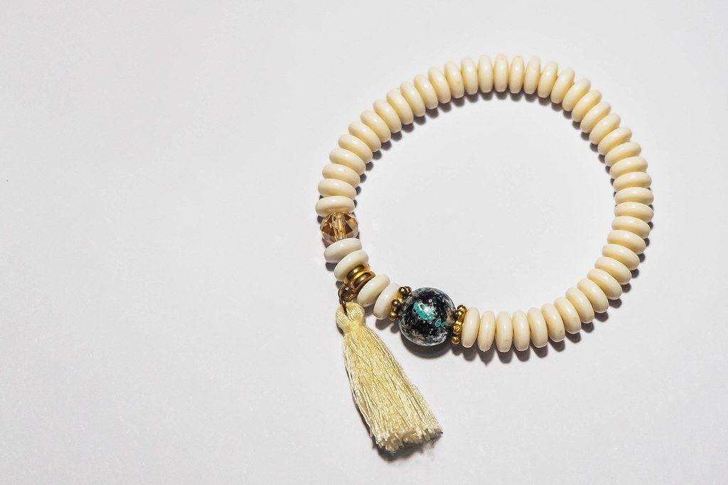 A handmade bracelet on white surface