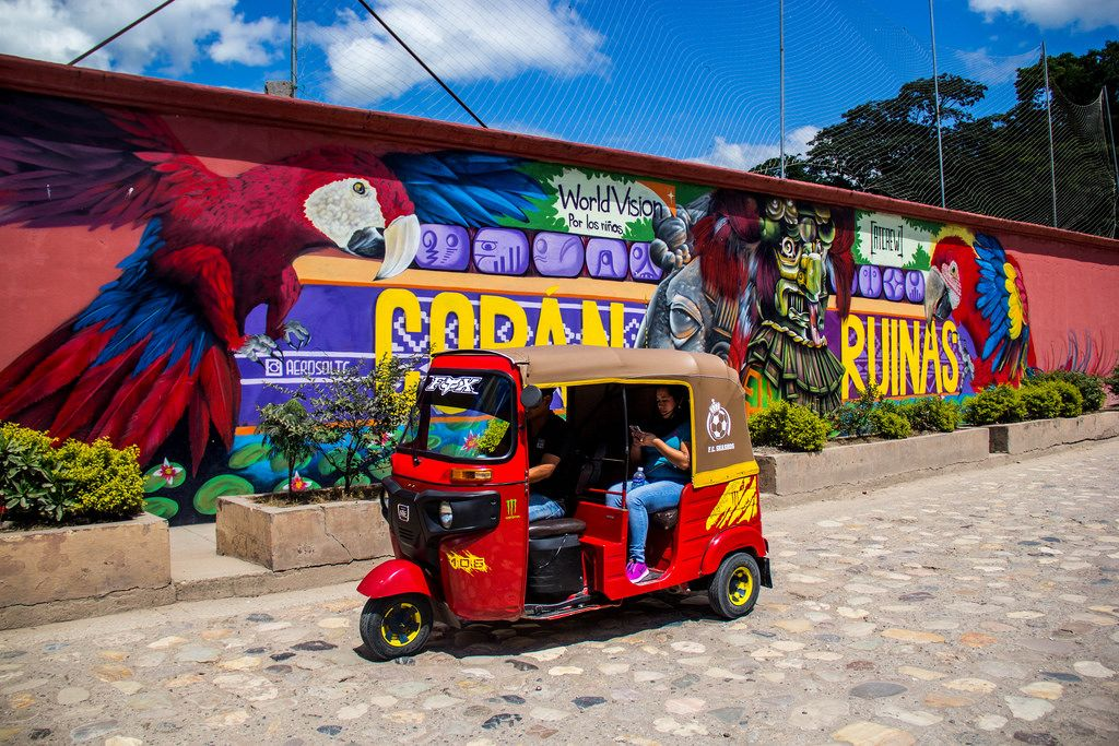 A Local Taxi Passing Through a Graffiti Painting