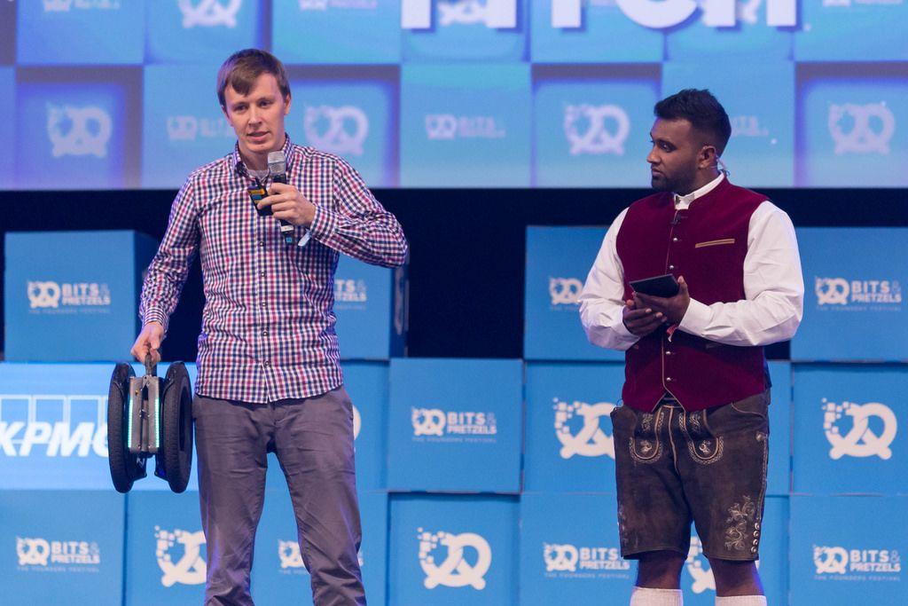 A man gives a speech next to Dan Ram