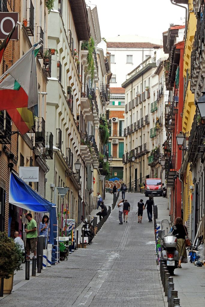 A narrow, winding street in the city of Madrid, Spain