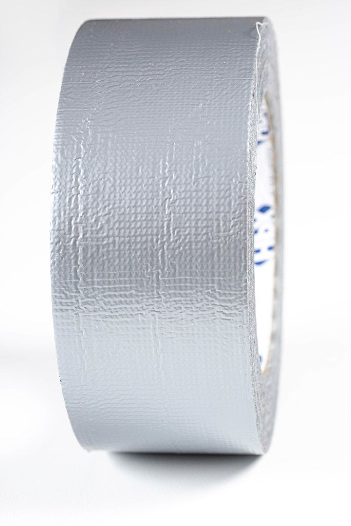A roll of gray adhesive tape close-up (Flip 2019)