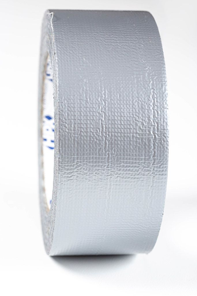 A roll of gray adhesive tape close-up