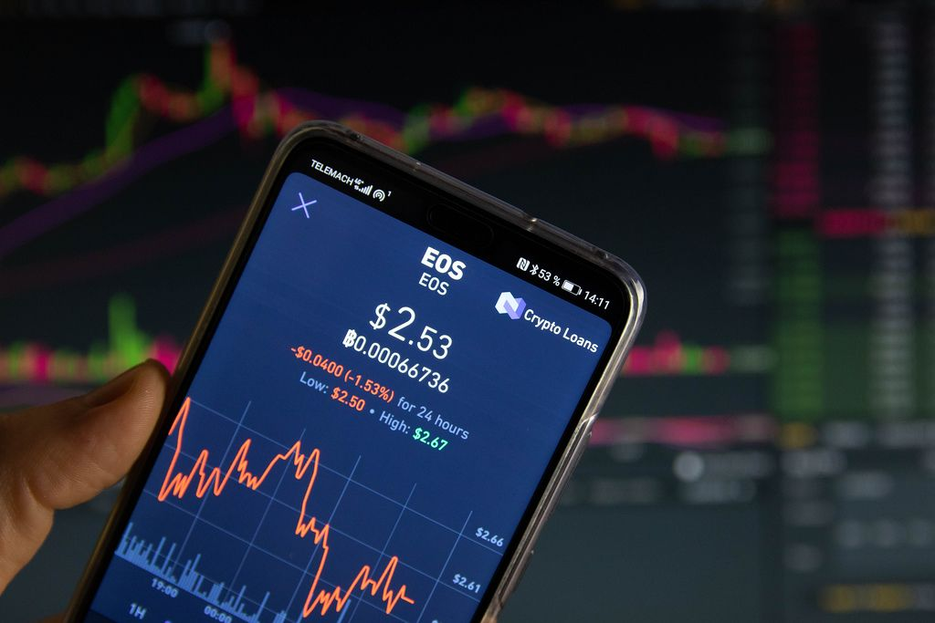 A smartphone displays the EOS market value on the stock exchange
