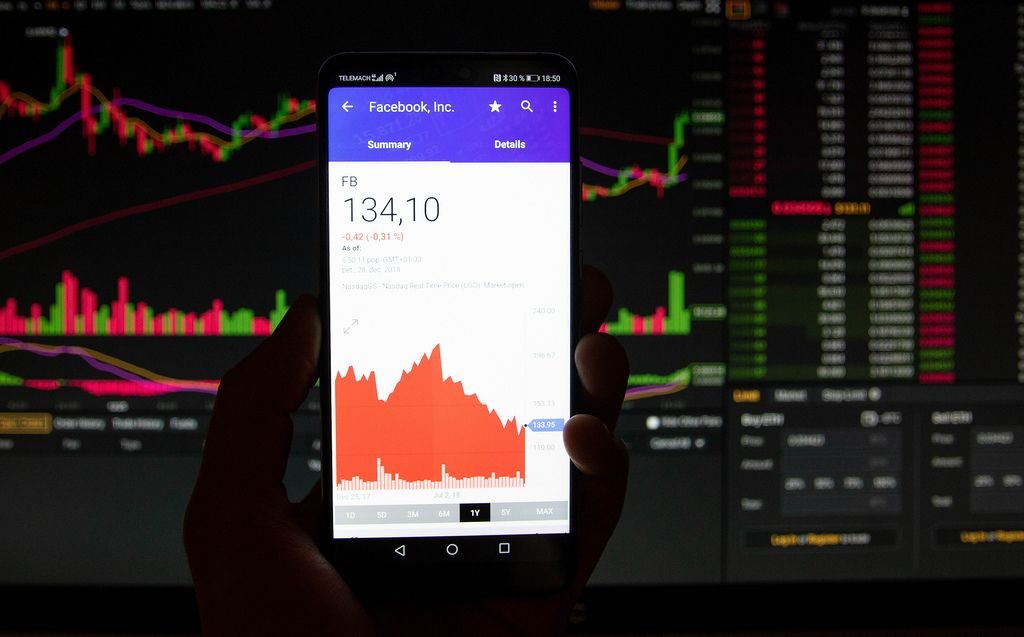 A smartphone displays the Facebook market value