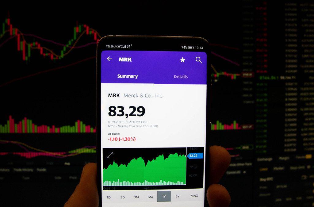 A smartphone displays the Merck & Co. Inc. market value