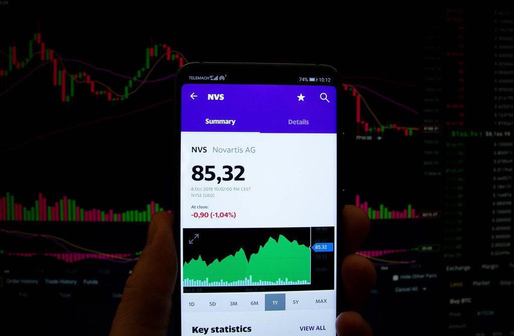 A smartphone displays the Novartis AG market value