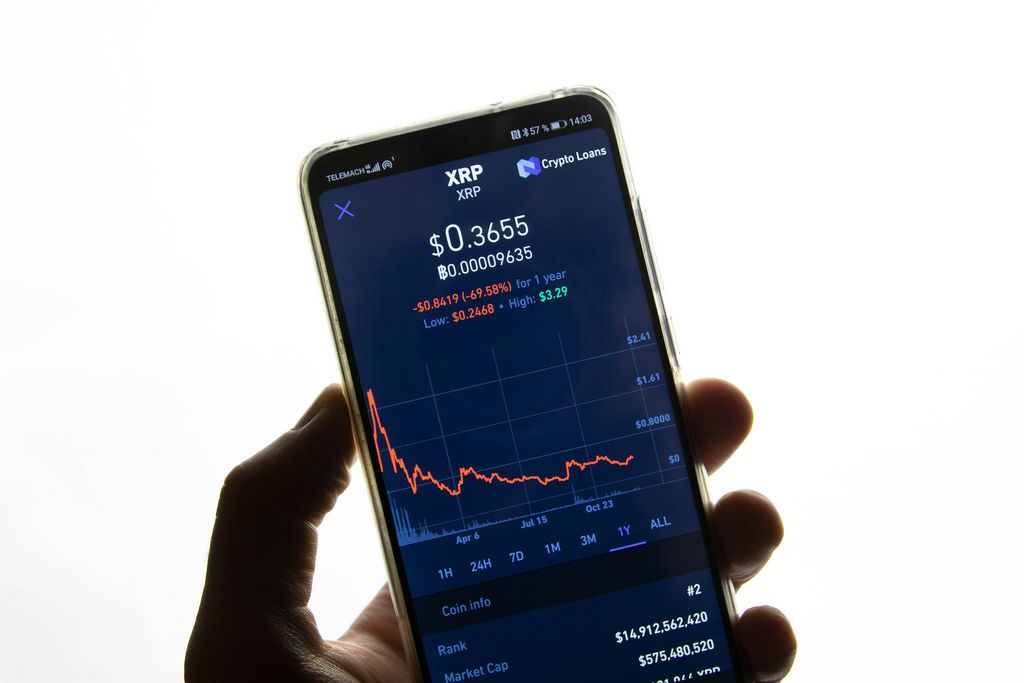 A smartphone displays the Ripple market value on the stock exchange