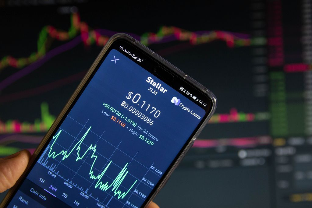 A smartphone displays the Stellar market value on the stock exchange