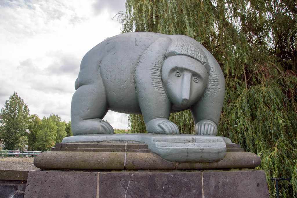 A statue of a bear on the bridge over the Spree river in Berlin, Germany