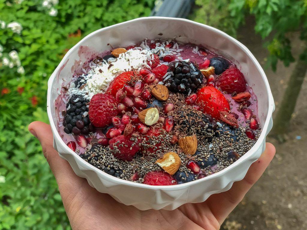 Acai Bowl with raspberry, strawberry, blackberry, pomegranate, almond and chia