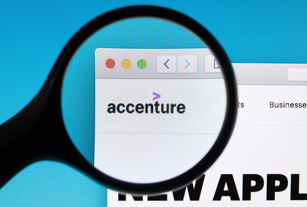 Accenture logo under magnifying glass