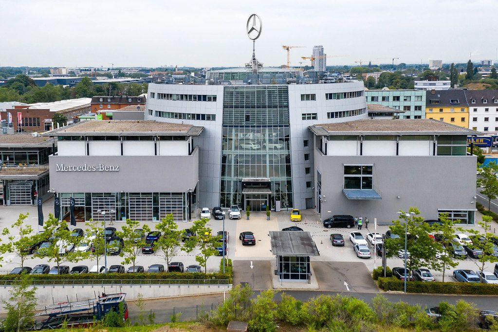 Aerial photo shot with the drone DJI Mavic Pro 2, showing Mercedes-Benz branch in Cologne and a large Mercedes star on the roof