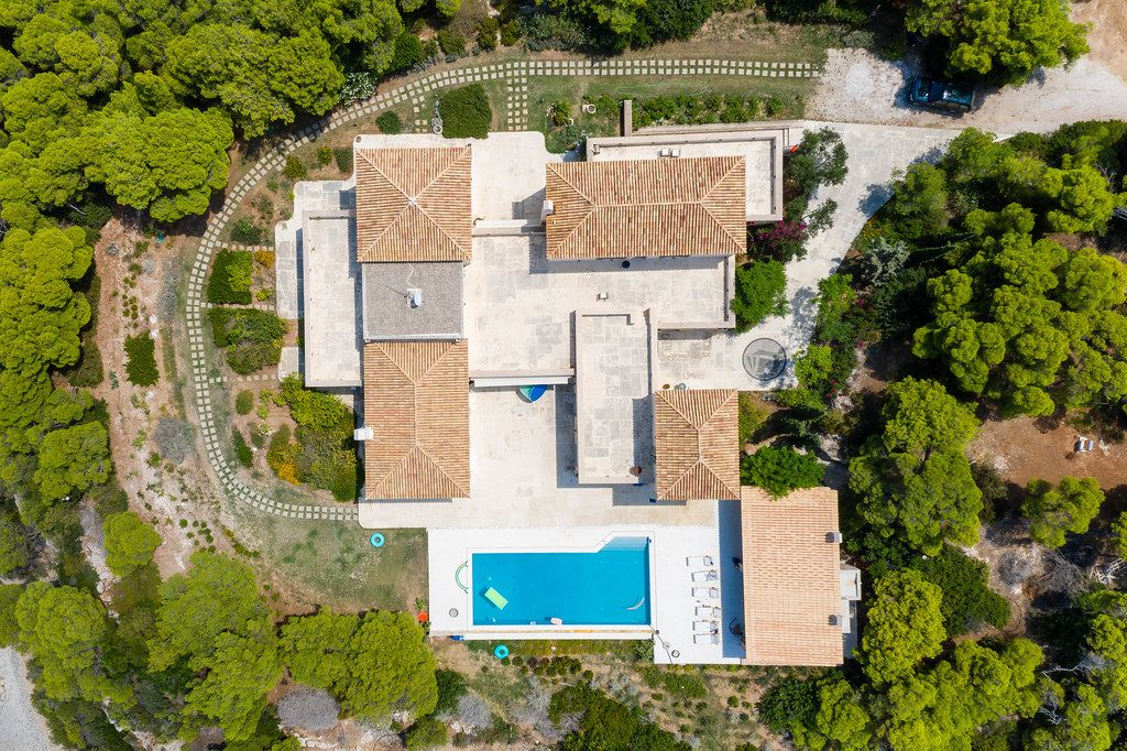 Aerial picture of a luxury house with private pool and garden on the greek island Spetses