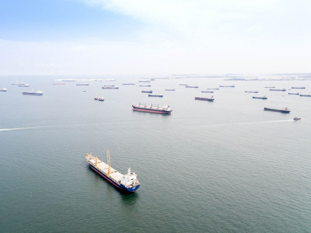 Aerial: Ships in front of Singapore