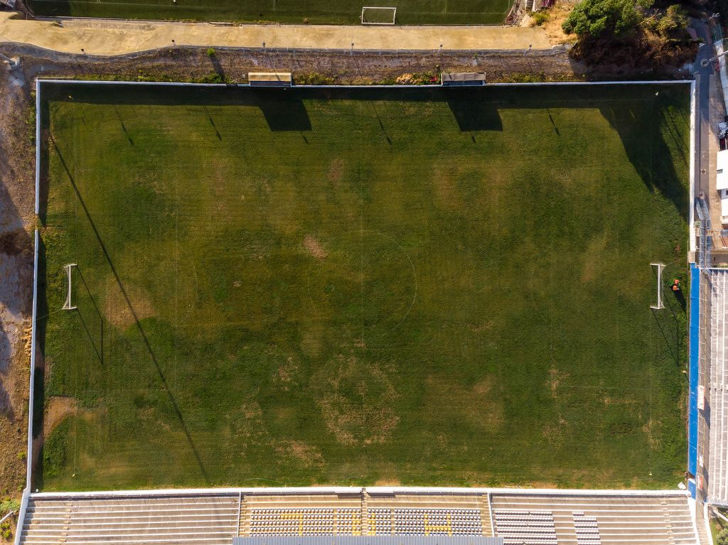 Aerial view drone shot of a football court in Almada Lisbon
