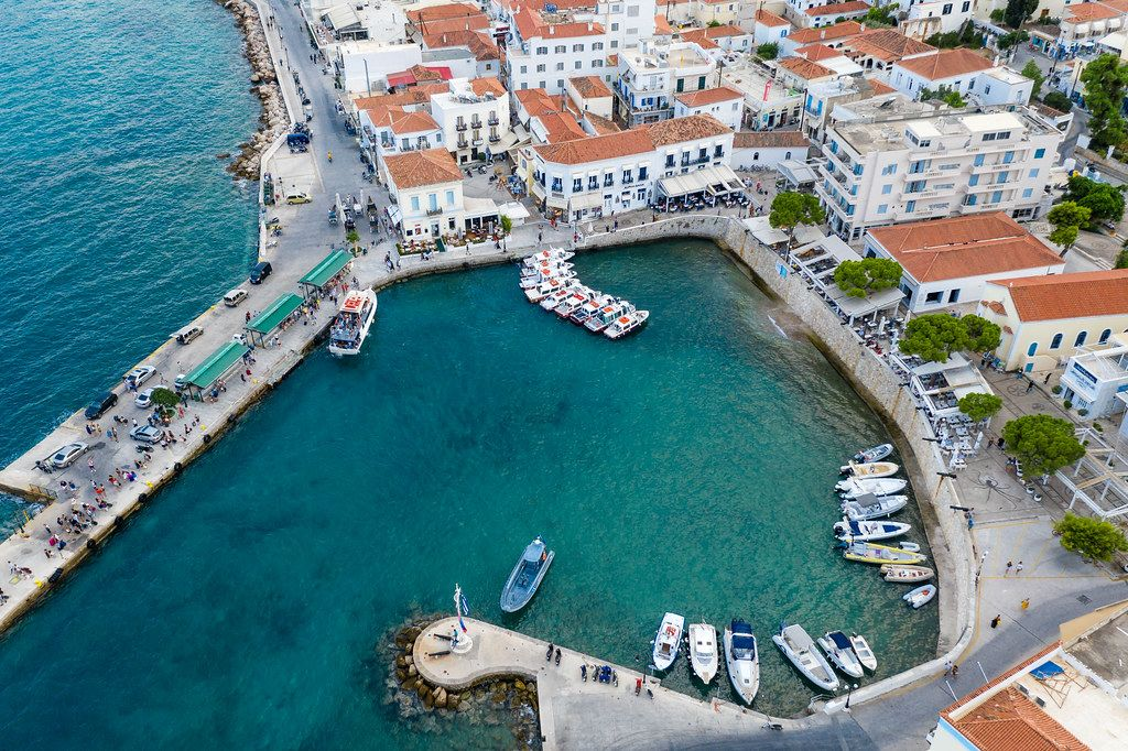 Aerial view of a small bay and busy streets at Spetses, Greece, with water taxis for island hopping