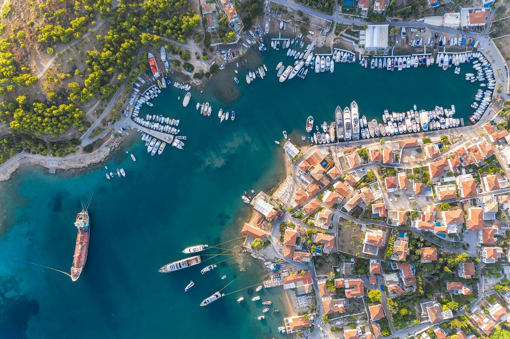 Aerial view of the harbour bay of Kouzounos, southeast of Spetses, Greece, Archipelago Saronic Islands