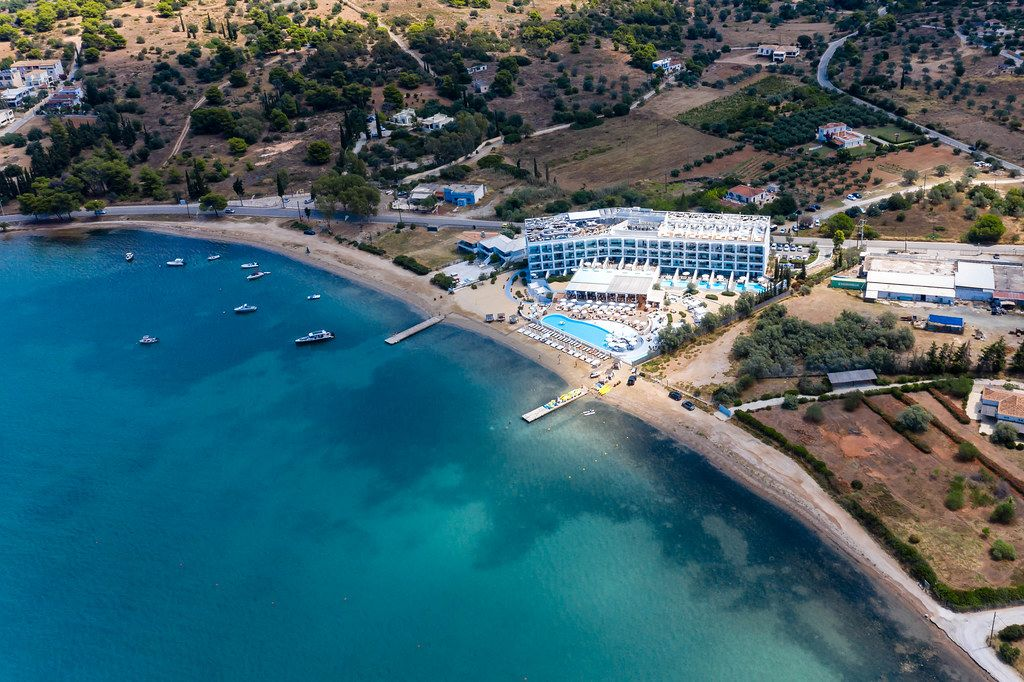Aerial view of the Nikki Beach Resort & Spa Hotel with pool at the coast of Argolic Golf, in Porto Heli, Kranidi, Greece