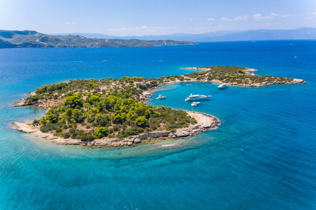 Aerial view of yachts in a bay of the tiny Island Chinitsa Nisi, in the Myrtoan Sea in Greece