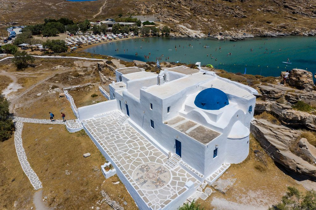 Aerial view shows Monastery of St. John's of Deti, in the valley of butterflies and nature park of Paros, Greece, with Monastiri Beach in the back