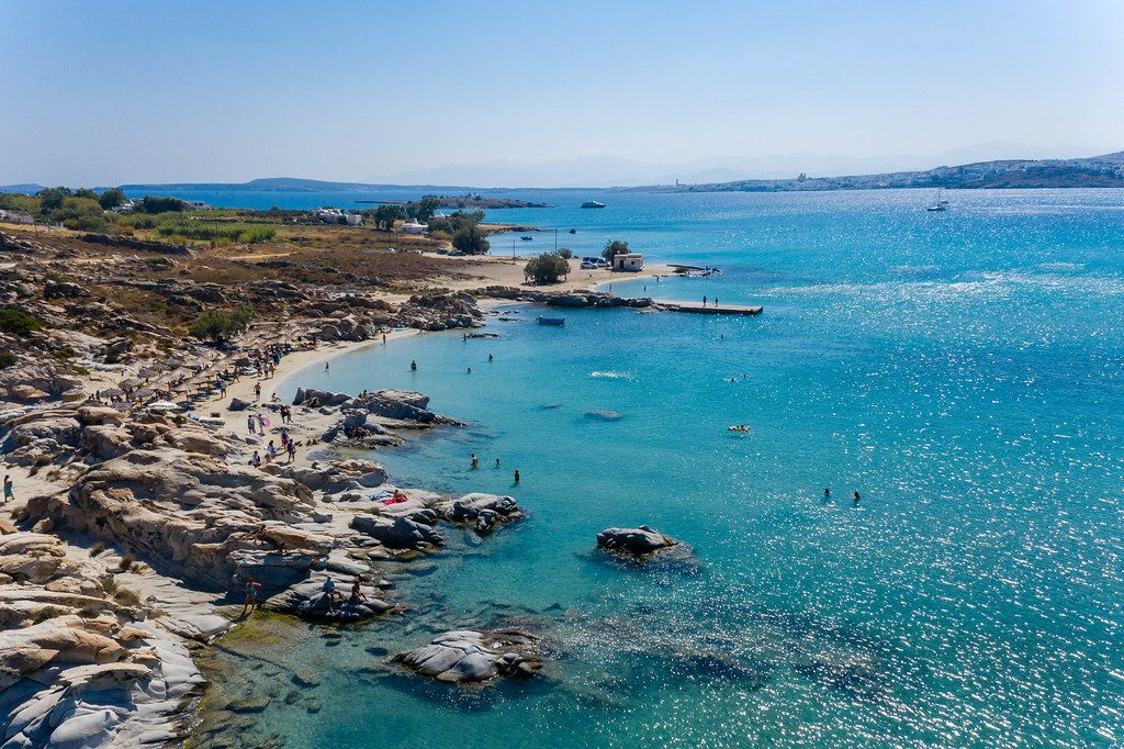 Aerial view shows the granite rocks in a small bay at the beach Kolimbithres on Paros, Greece, with the blue sea