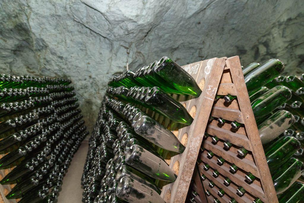 Ageing champagne in bottle in wooden pupitre (Flip 2019)