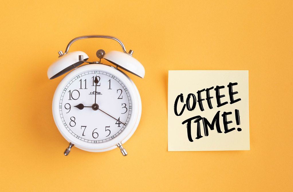 Alarm clock with handwritten text Coffee Time