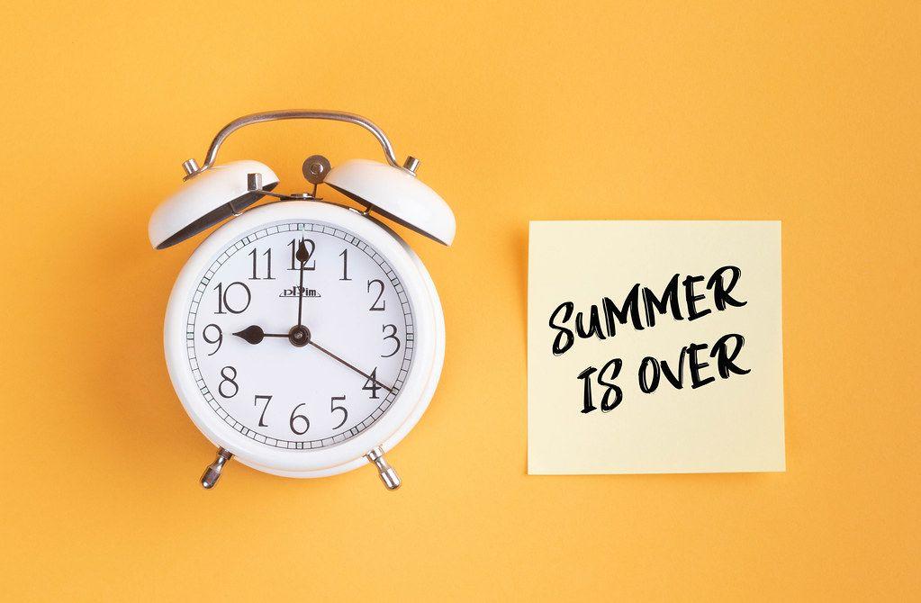 Alarm clock with handwritten text Summer is Over