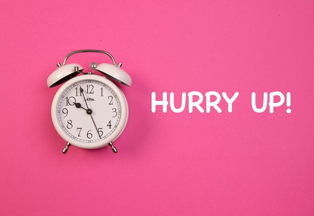 Alarm clock with Hurry Up! text