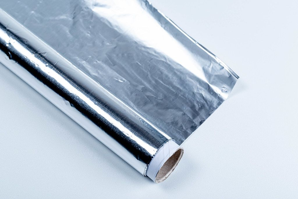 Aluminium foil roll on white background