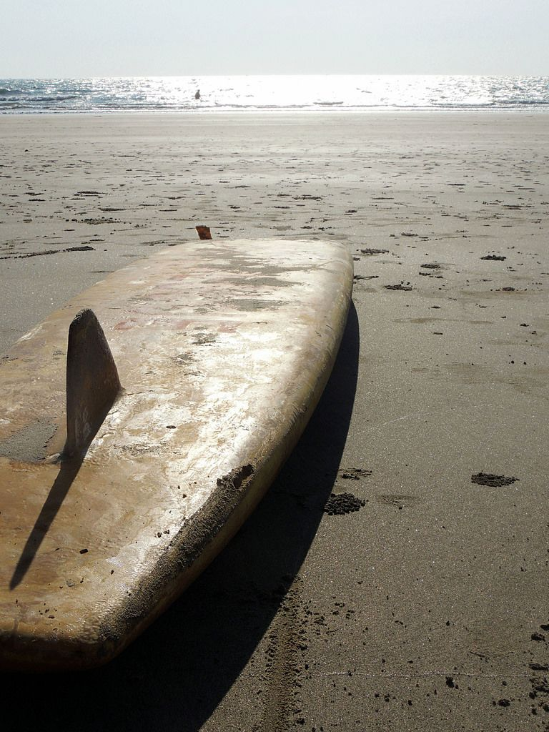 An abandoed surfboard on the beach of Goa, India