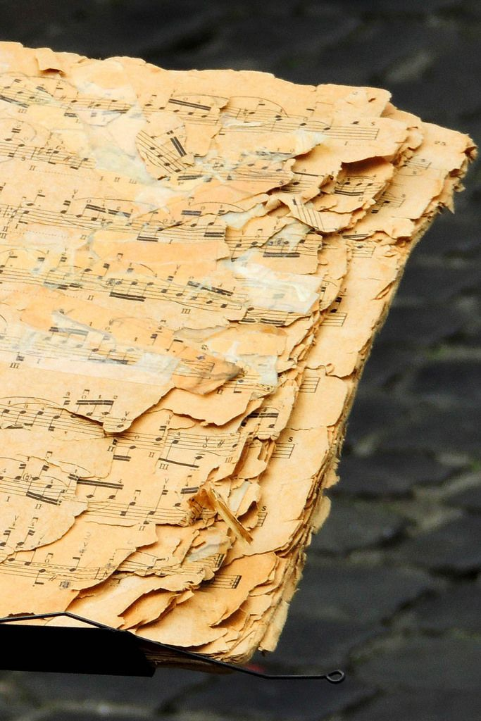 An old music notebook used by a street musician in Rome, Italy