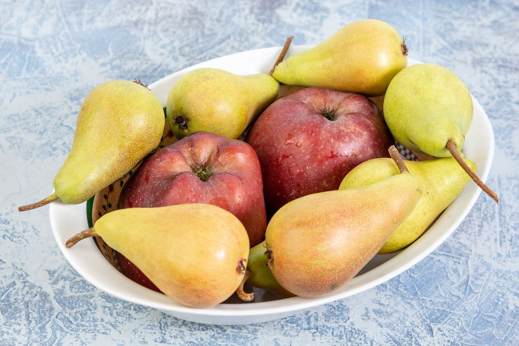 Apples and Pears in the bowl on the table
