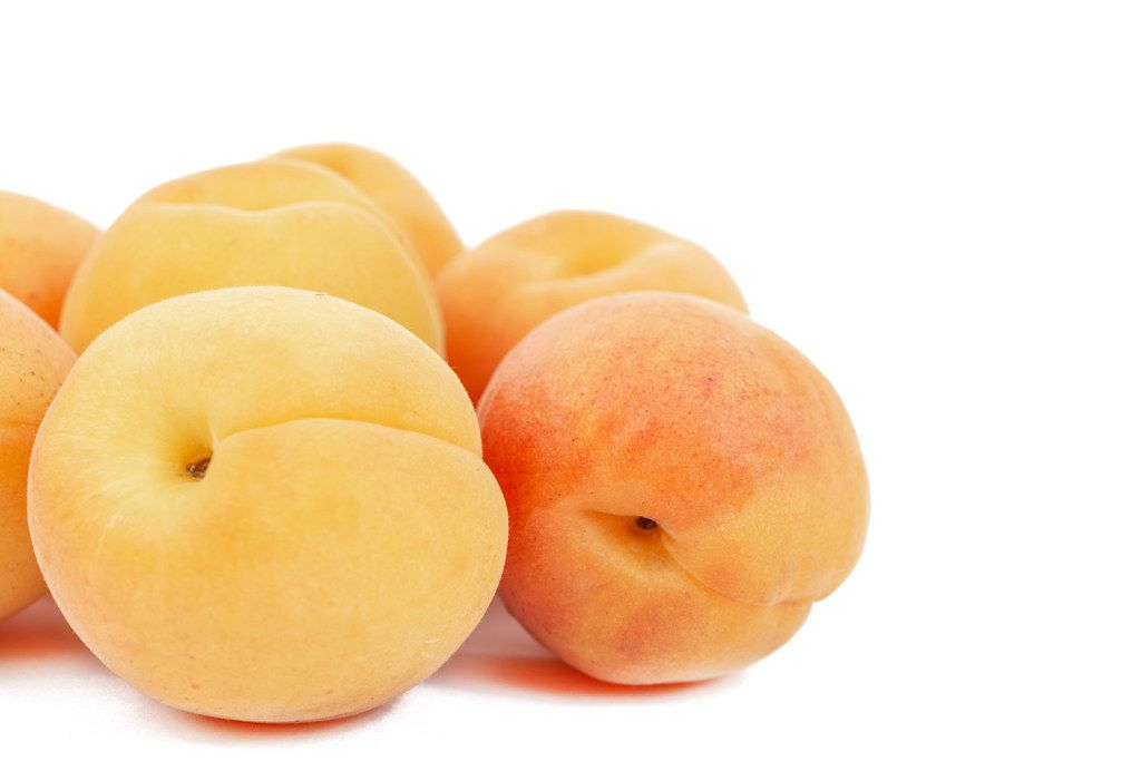 Apricots isolated above white background