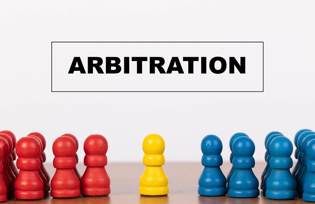 Arbitration concept with pawn figurines on table