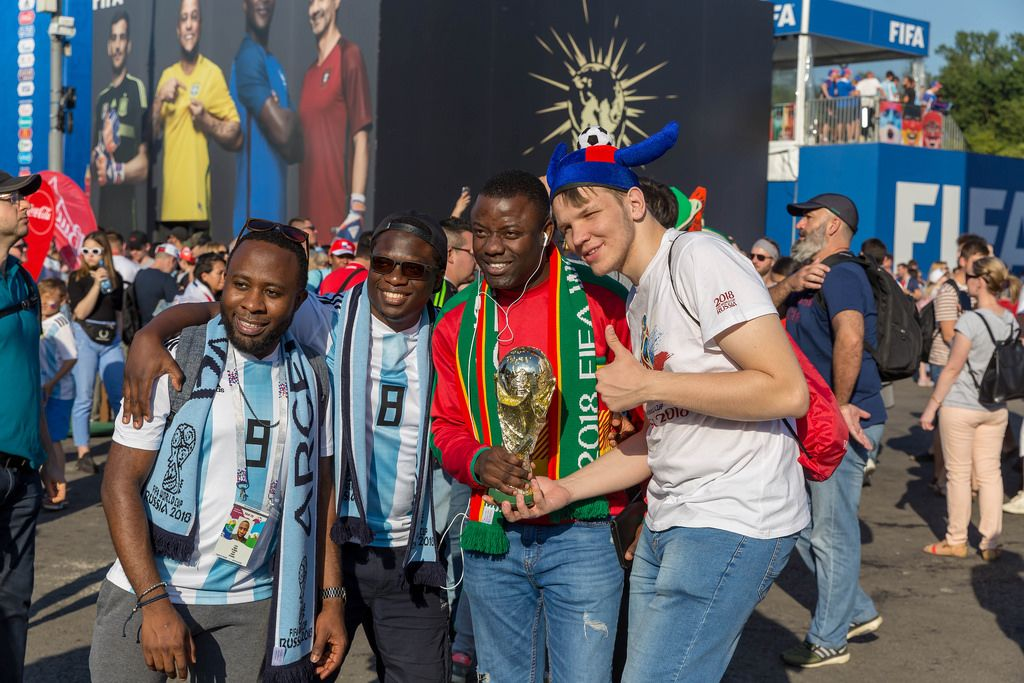 Argentinian soccer fans with trophy posing for photos