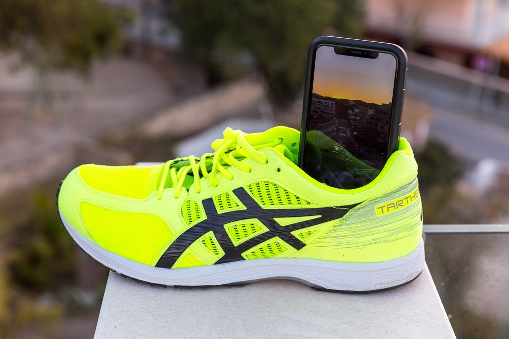 ASICS running shoe being used as a smartphone tripod