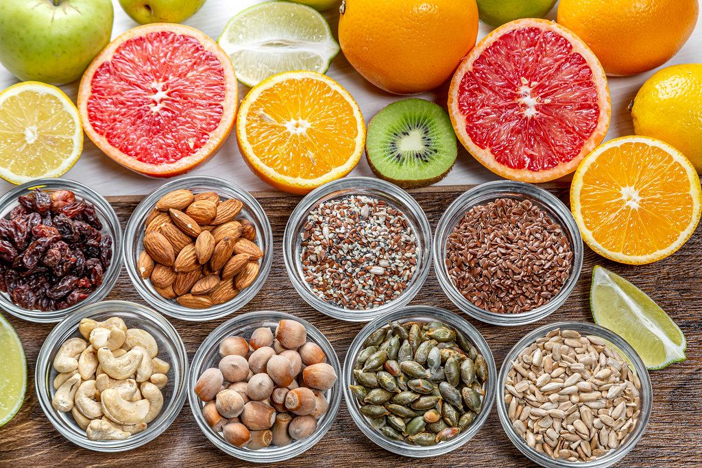 Assortment of colorful fresh fruits, nuts and seeds. Top view