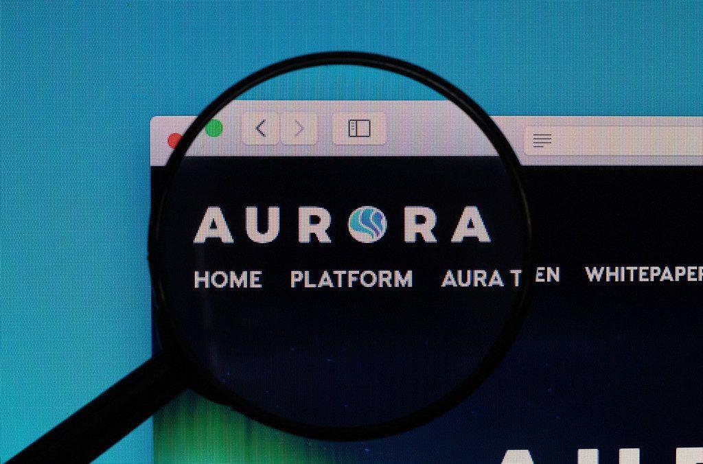Aurora logo under magnifying glass