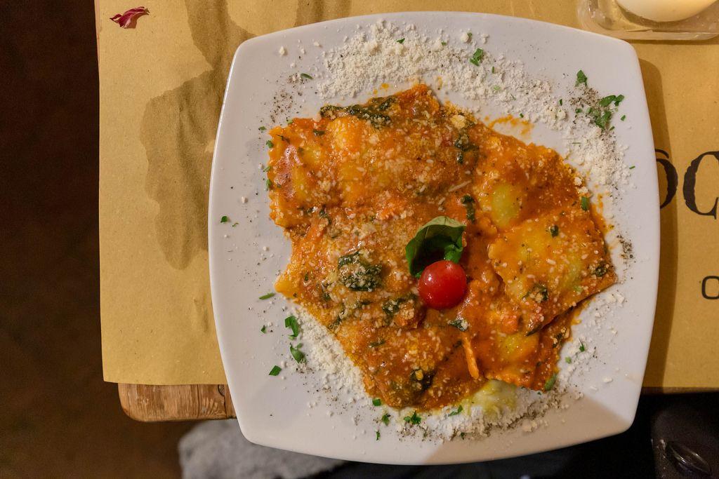 Authentic italian ravioli with tomato sauce and basil at mimi e cocos wine bar in Rome