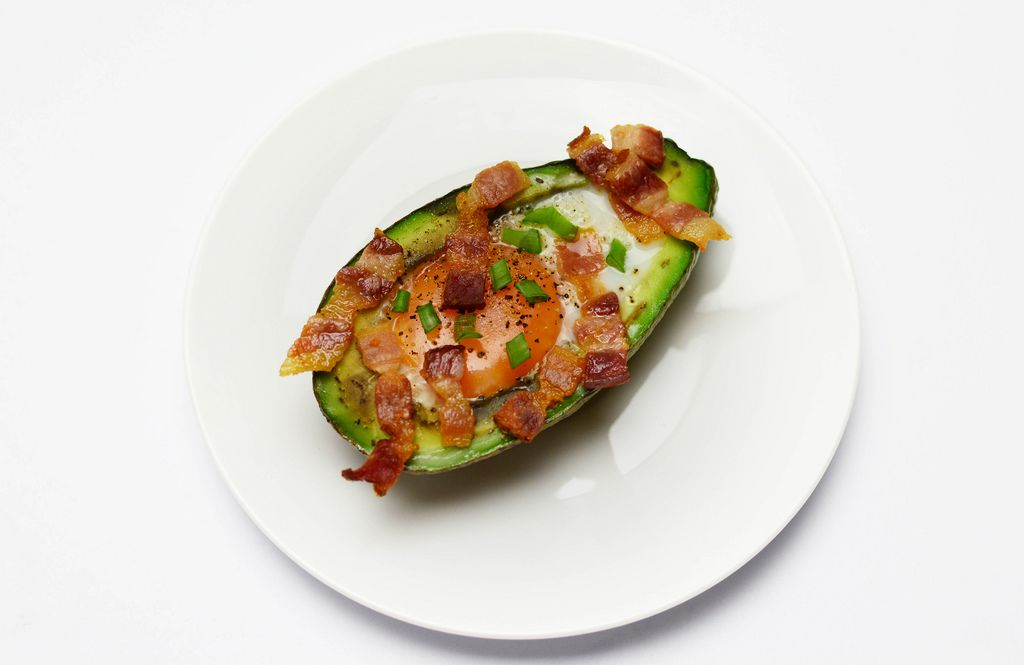 Avocado baked with egg and bacon