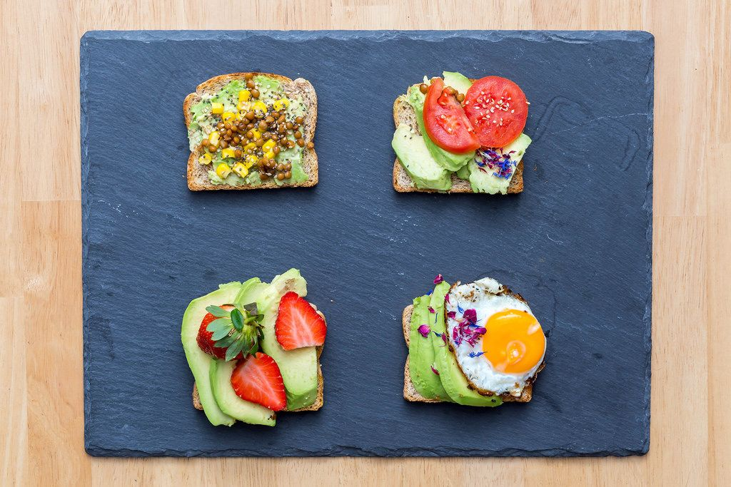 Avocado Sandwiches with Lentil, Strawberries, fried egg and tomatoes
