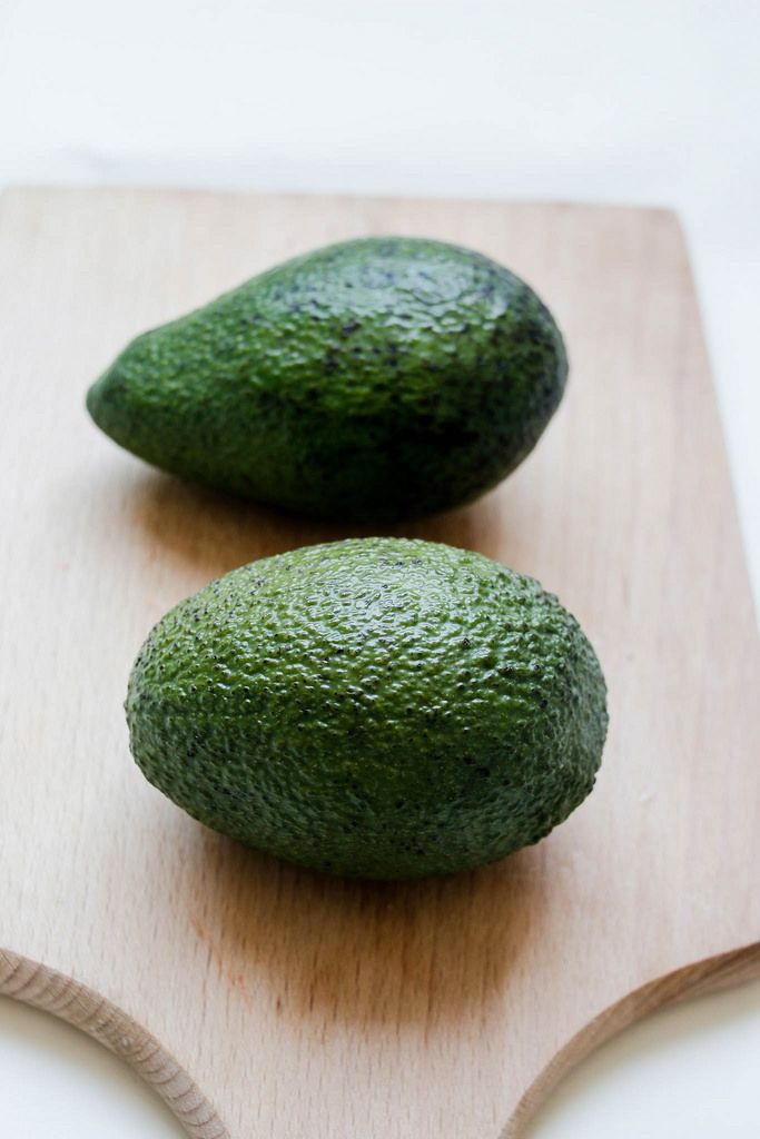 Avocados on wooden board